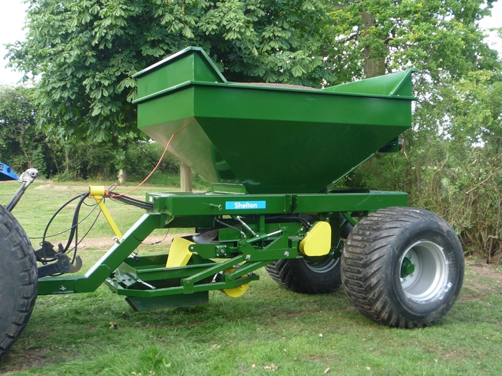 Shelton 6 tonne fast flow gravel and sand hopper hitched to tractor