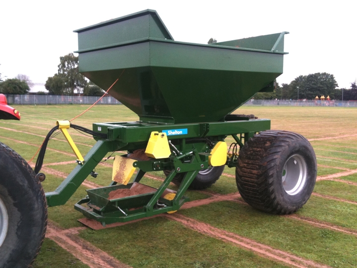 Shelton 6 tonne fast flow gravel and sand hopper in operation on playing field