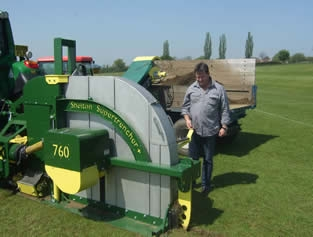 Nic Hansen of Total Turf Care in Tasmania inspecting the Shelton Supertrencher+760