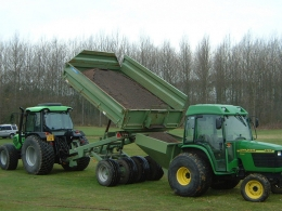 Shelton Hi Lift trailer in action loading hopper
