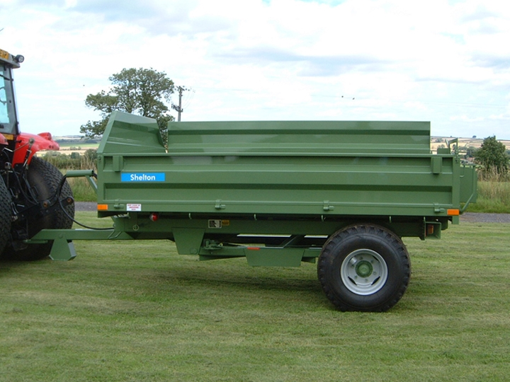 Shelton Hi Lift trailer hitched to tractor side view